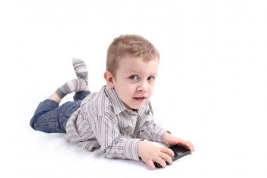Boy Laying and playing with phone