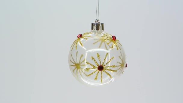 Vymažte skleněná vánoční ozdoba s zlatá vločka vzor fullhd 1080p