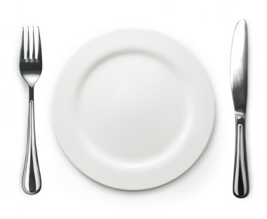 Photo of the fork and knife with white plate on white