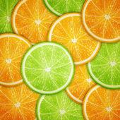Fotografie Orange and lime fruit slices background