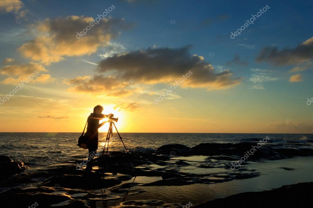 Silhouette shot of a photographer at sunset. Taken at the Tip of Borneo, Borneo, Sabah, Malaysia.