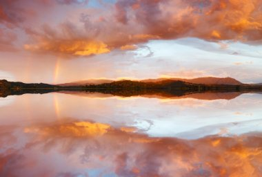 Reflection of dramatic and colorful sunset clouds
