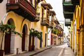 Photo Typical street scene in Cartagena, Colombia of a street with old