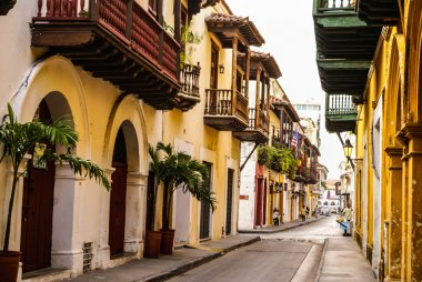 Typical street scene in Cartagena, Colombia of a street with old