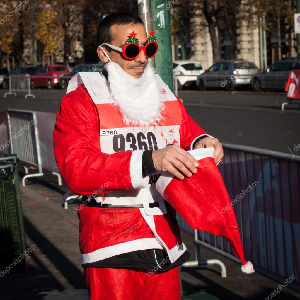Almost 10.000 Santas take part in the Babbo Running in Milan, Italy