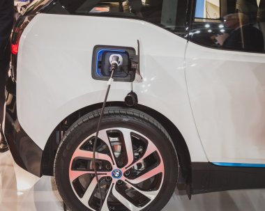 Detail of an electric car under charge at Solarexpo 2014 in Milan, Italy