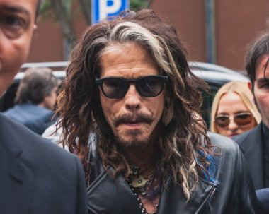 Singer Steven Tyler outside Armani fashion shows building for Milan Men's Fashion Week 2014