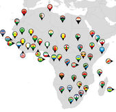 Photo Pinned countries flags on map of Africa