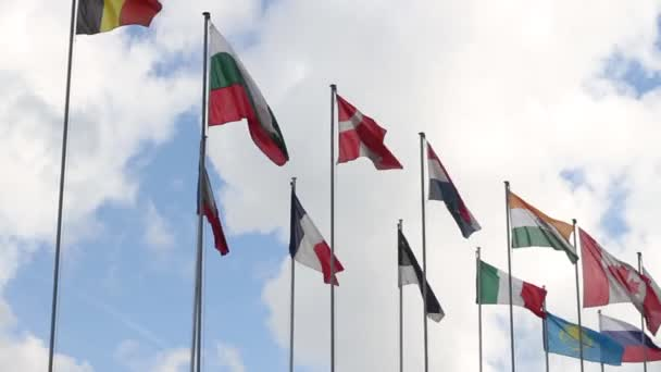 Flags of different countries flying on wind