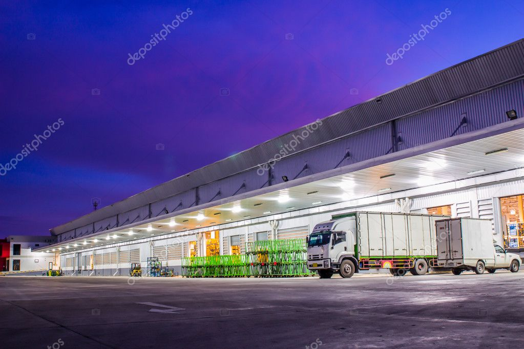 White trucks parked on a parking places in warehouse