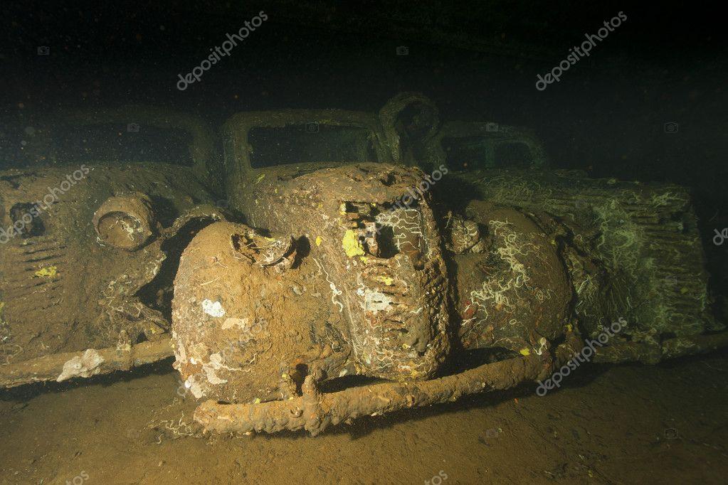 Old Car inside II world war ship wreck hold — Stock Photo © izanbar ...