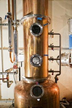 Copper still alembic inside distillery to distill grapes and produce spirits stock vector