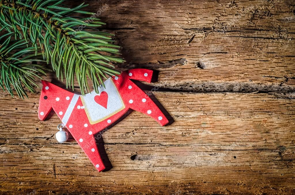 CRed Horse, Christmas decoration, and pine branch on wood, with copy space
