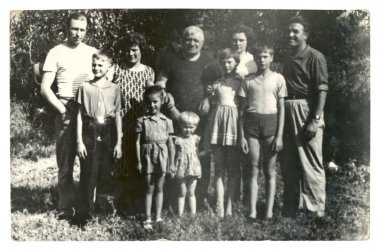 Family photographs of people of different ages in a rural summer orchard