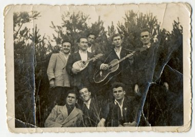 Men (one with a guitar, one with balalaika)