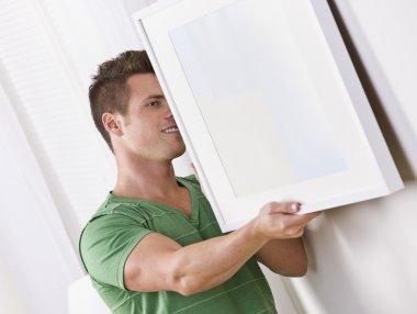 Man Hanging Frame