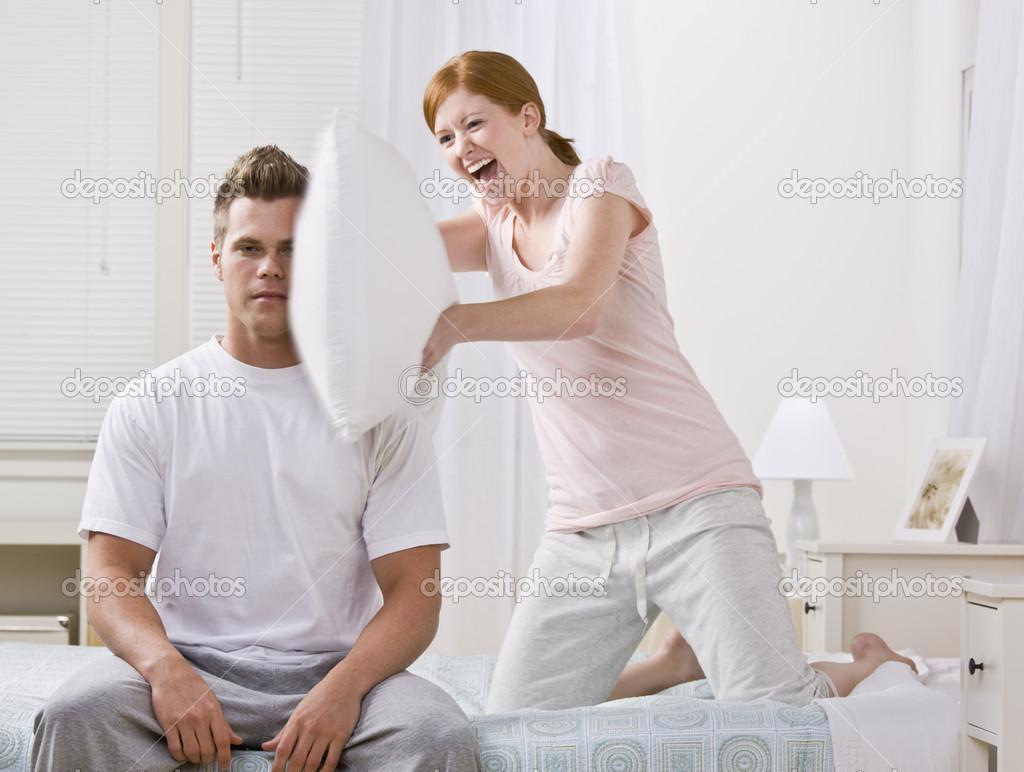 https://st.depositphotos.com/1905901/1876/i/950/depositphotos_18763341-stock-photo-cute-redhead-hitting-with-pillow.jpg