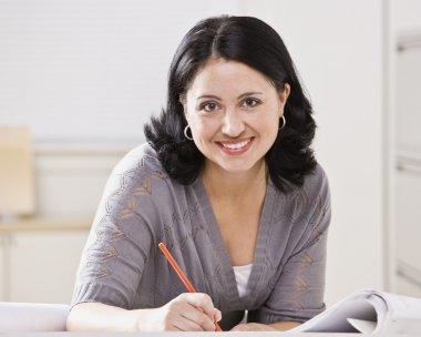 Beautiful Hispanic Woman Writing