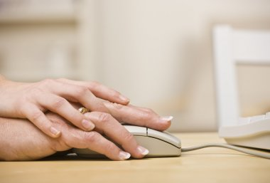 Woman Helping Older woman use Mouse