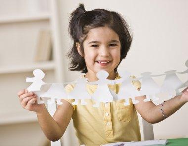 Girl Making Paper Dolls