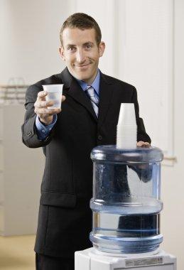Businessman at Water Cooler