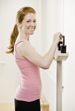 Young Woman Weighing Self