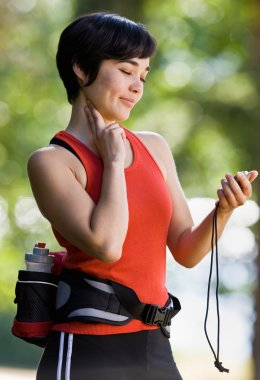 Runner checking pulse after exercising