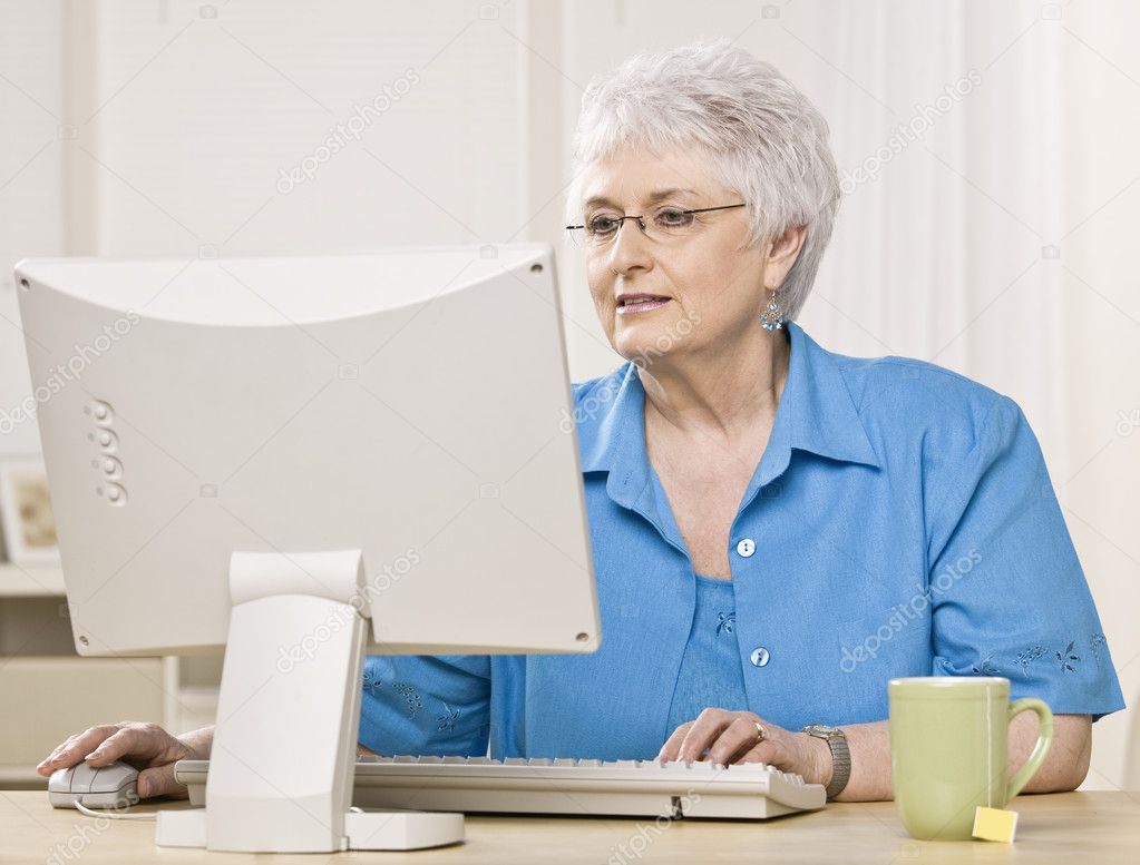 old woman on computer