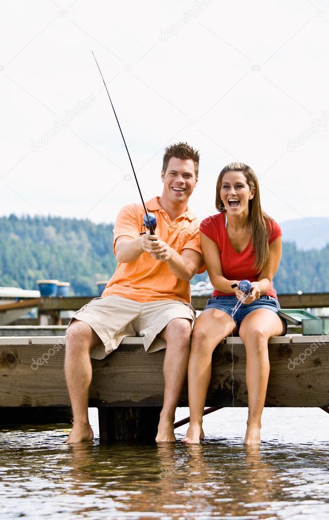 Couple fishing on pier