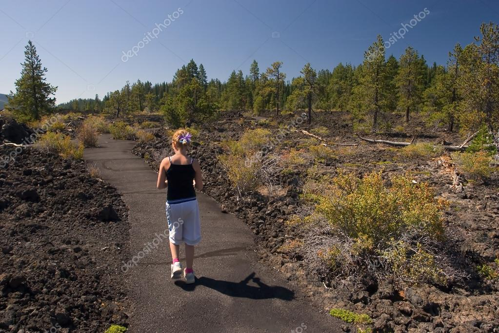 Girl Walking through Lava Rocks