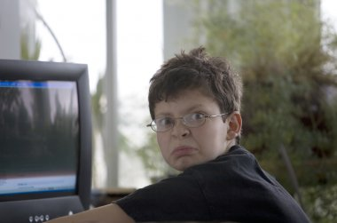 Middle School Boy Using a Computer