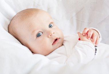 Cute newborn baby smiling