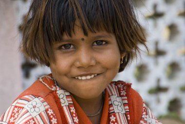 A poor slum girl from India