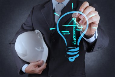 engineer drawing lightbulb and construction