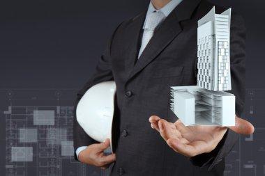 hand presents building development as concept