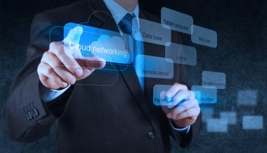 Businessman hand pointing on a Cloud Computing diagram