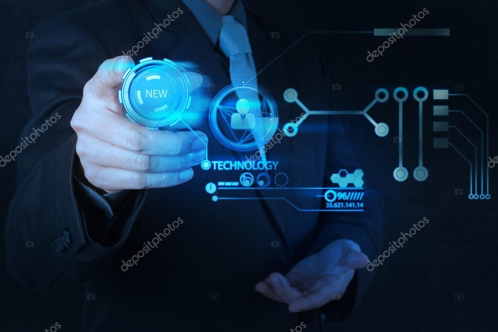 businessman hand pushing new technology button on modern comput