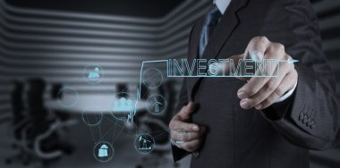 businessman hand pointing to investment