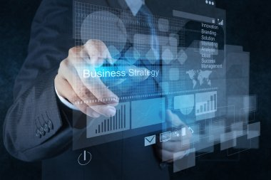 businessman hand points to business strategy