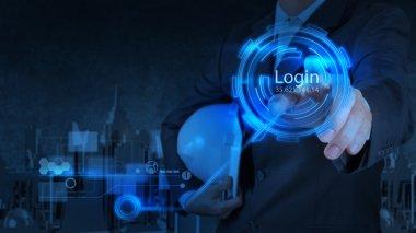 businessman pressing login button on internet