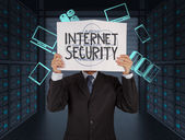 Fotografie businessman hand showing Internet security word on book online b