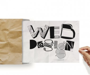 hand holding web design handrawn icons on paper background poste