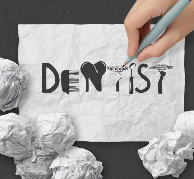 design word  DENTIST on white crumpled paper and texture backgro