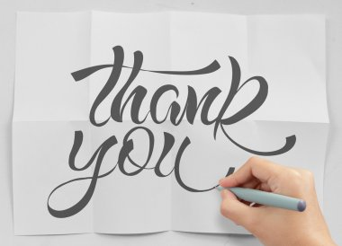 businessman hand show design word THANK YOU on crumpled paper as