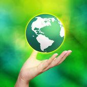 Fotografie 3d earth globe in his hands