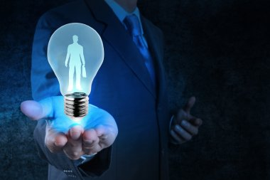 businessman with  light bulb  choosing people icon as human reso