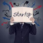 Fotografie Businessman hand show book of startup