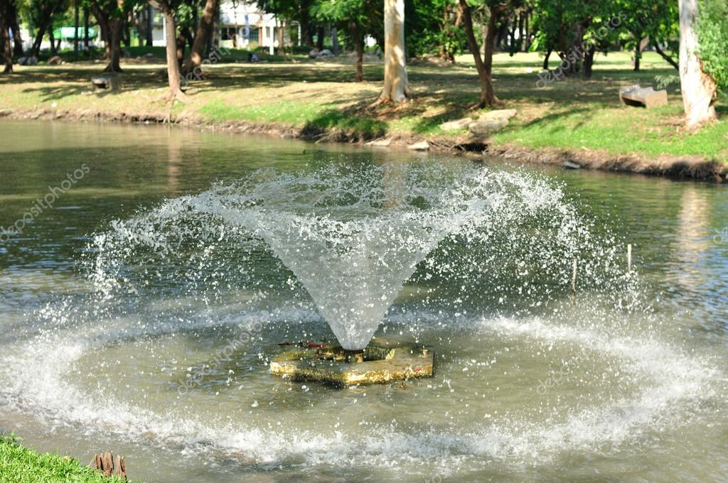 Small fountain floating on lake