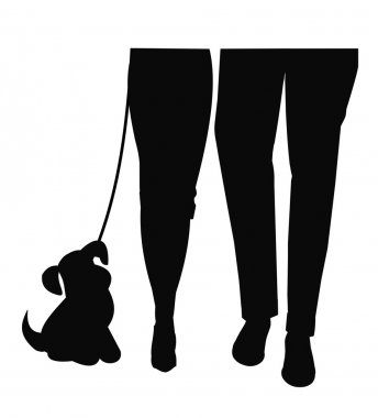 Man and woman walking dog in silhouette