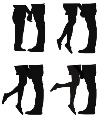 People holding hands in silhouette